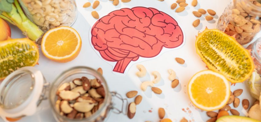 Human brain drawing and healthy fresh food on the table
